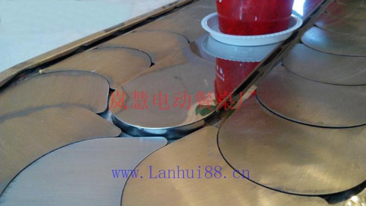 不锈钢五金架大理石面椭圆型输送带餐桌